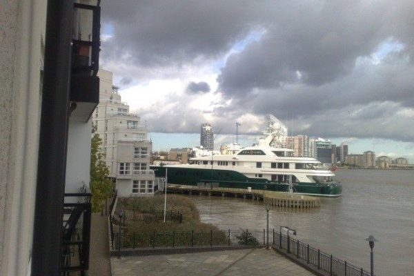 Boat going into Canary Wharf Dock